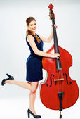 Business woman with double bass. — Stock Photo