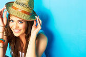 Girl hipster on blue background — Stock Photo