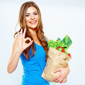 Woman winner with green food — Stock Photo