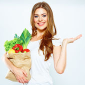 Woman with green food show empty hand. — Stockfoto