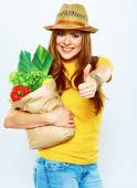 Woman holding paper bag with vegetarian food. — Stock Photo