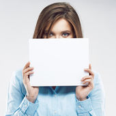 Office worker hiding face behind  banner. — Stock Photo