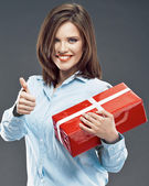 Businesswoman hold red gift box show thumb up — Stock Photo