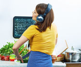 Young girl cooking with fun — Stock Photo