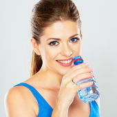 Active woman drinking water of bottle — Stock Photo