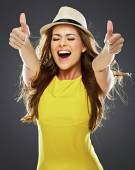 Smiling young woman show thumb up — Stock Photo