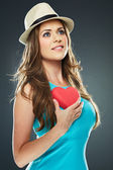 Beautiful romantic woman hold red heart — Stock Photo
