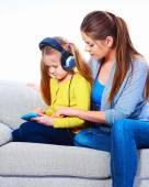 Mother with child learning home work — Stock Photo