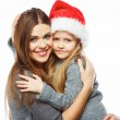 Child embrace her mother — Stock Photo #57950625