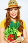 Woman holding paper bag with vegetables — Stockfoto