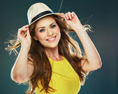 Young woman in yellow dress and hat — Stock Photo
