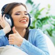 Girl with headphones and thumb up — Stock Photo #60938617