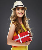 Girl holding red present box — Stock Photo