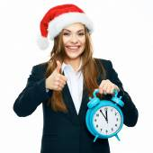 Businesswoman holds watch — Stock Photo