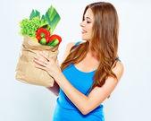 Woman holding vegan food — Stock Photo
