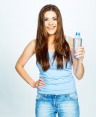 Woman holding bottle of water — Stock Photo