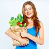 Woman holding bag with food — Stock Photo