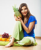 Young woman with pineapple — Stock Photo