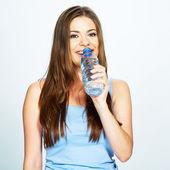 Woman drinks bottle of water — Stock Photo