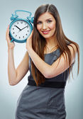 Businesswoman holding watch. — Stock Photo