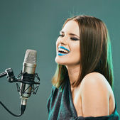 Woman singer with blue lips — Stock Photo
