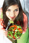 Woman eats green salad — Stock Photo