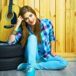 Dreaming girl sitting with guitar — Stock Photo #64563381