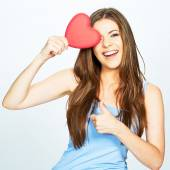 Woman with heart showing thumb up — Stock Photo
