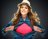 Smiling woman ripping clothes — Stock Photo