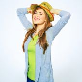 Smiling woman posing with hat — Stock Photo