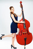 Young woman playing contrabass — Stock Photo