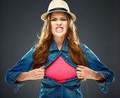 Aggressive woman ripping clothes — Stock Photo