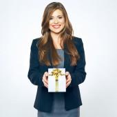 Businesswoman holds white gift box — Stock Photo