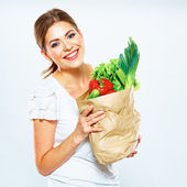 Woman with vegan food in bag — Stock Photo