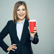 Businesswoman holds cup of drink — Stock Photo #68634723