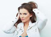 Woman posing in white jacket — Stock Photo