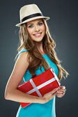 Girl holds red gift box — Stock Photo