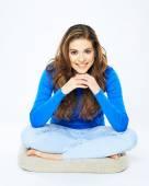 Smiling woman sitting on mat — Stock Photo
