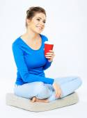 Young woman with coffee cup — Stock Photo