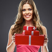 Woman holding red gift boxes — Stock Photo