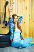 Girl sitting with guitar — Stock Photo