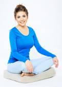 Woman sitting in yoga pose — Stock Photo