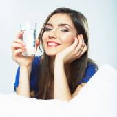 Woman holds water glass — Stock Photo
