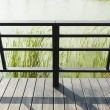Looking Down at Railing of Balcony or Boardwalk Facing Pond with — Stock Photo #68352737