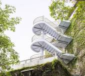 Modern Winding Staircases on Vine Covered Exterior Walls of Buil — Stock Photo