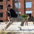 Two young men street dancing in a city square — Stock Photo #52914531