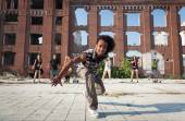 Energetic street dancer lunging at the camera — Stock Photo