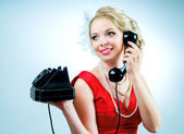 Woman with a telephone — Stock Photo