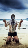 Zombie on the beach — Stock Photo
