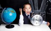 Schoolboy with a clock — Stock Photo